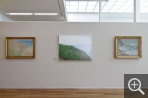"Partial view of the ""Les Territoires du désir"" exhibition. In the centre, The Valleuse d'Antifer, photograph by Véronique Ellena, displayed alongside Cliffs at Varengeville by Claude Monet, left. © MuMa Le Havre / Charles Maslard"